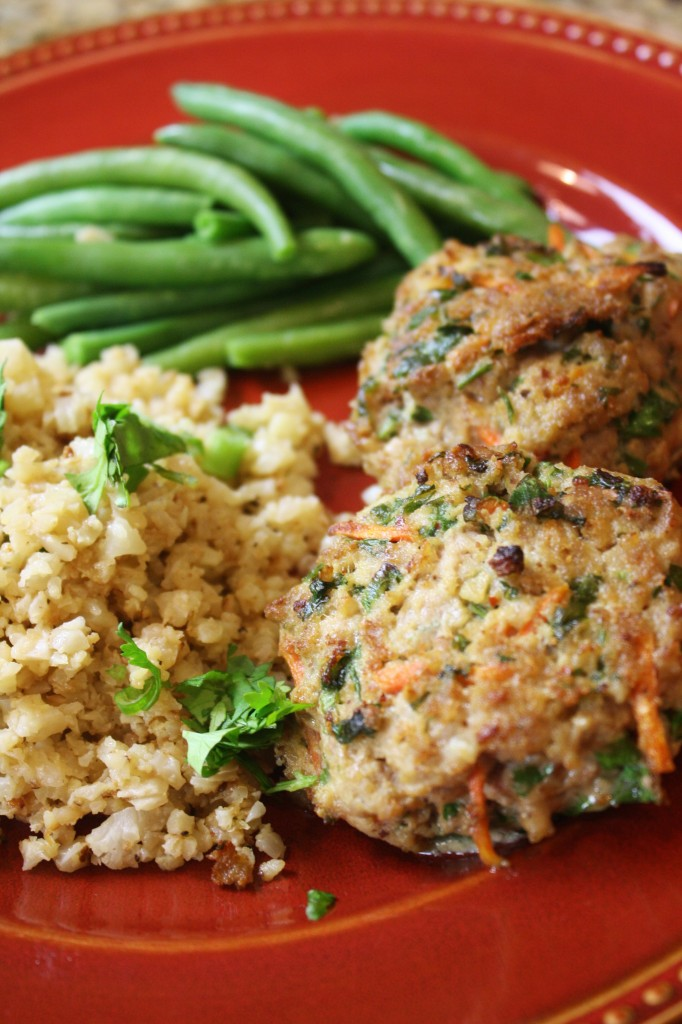 "Meatballs served with green beans and cauliflower ""rice"" on red plate"