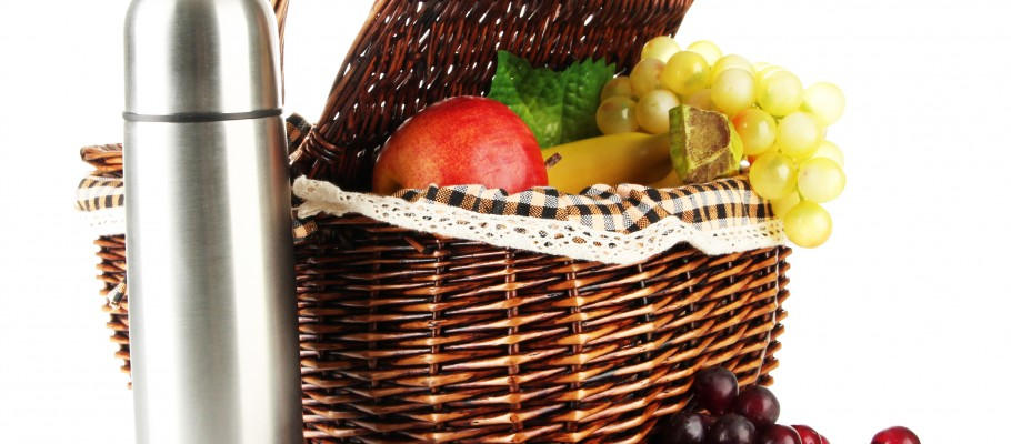 Picnic basket with fruit and thermos isolated on white