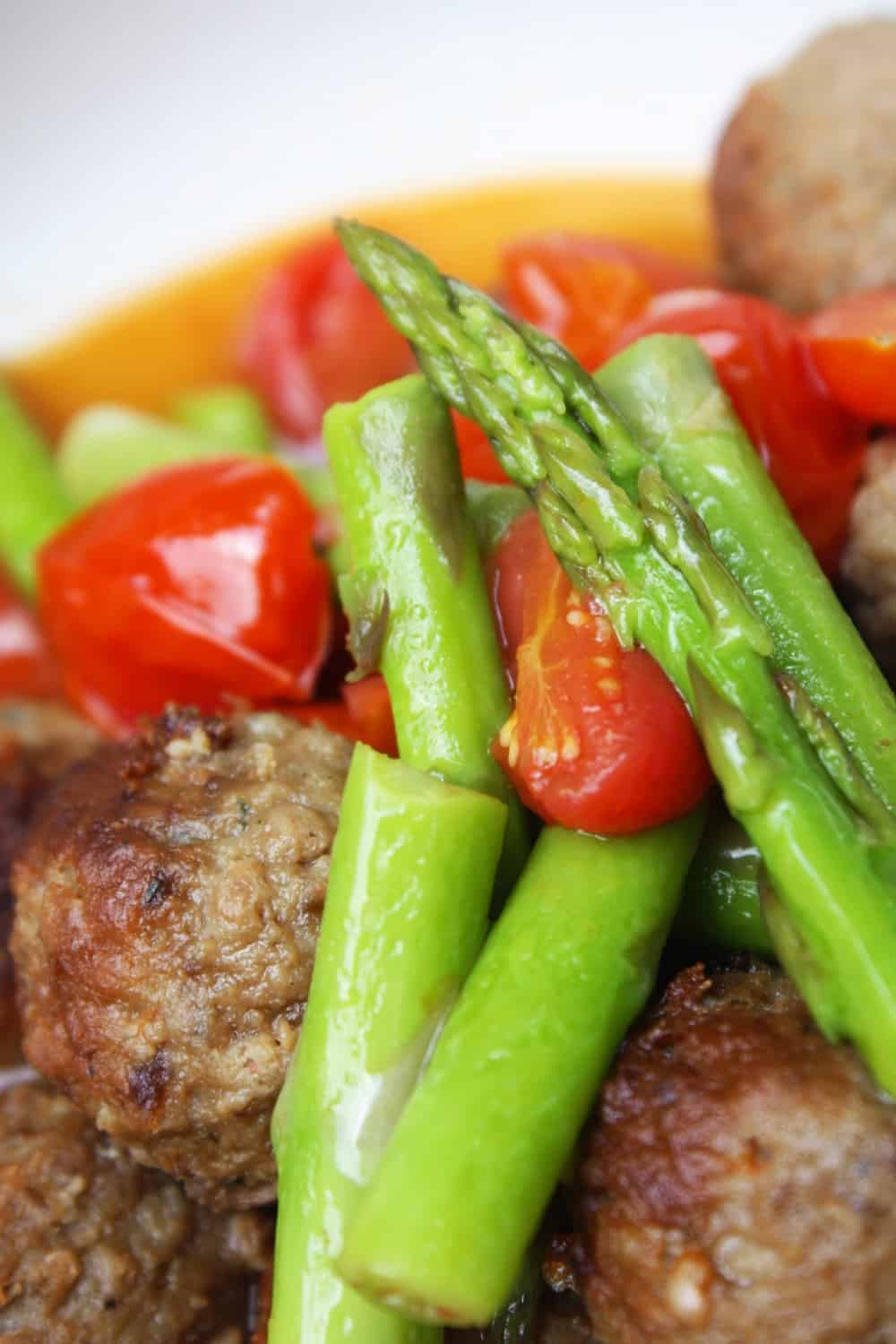 Meatballs with Warm Tomato and Asparagus Salad
