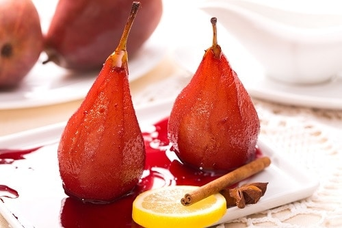 Two poached pears in red wine with cinnamon