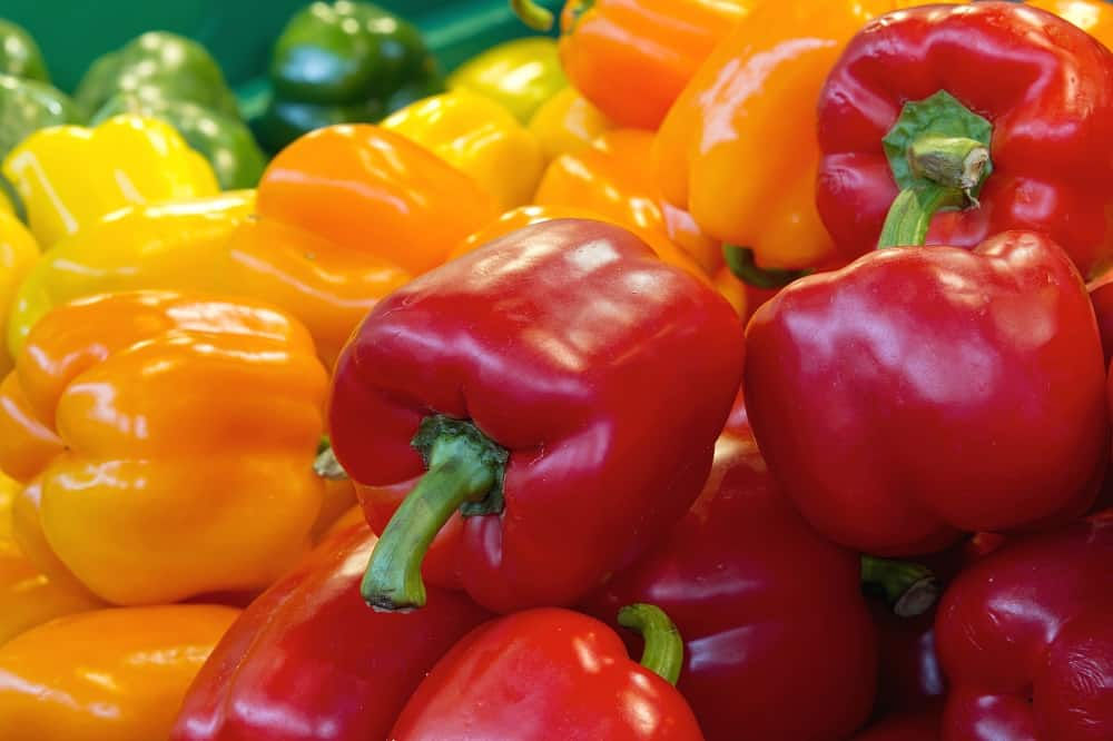 Red Yellow and Green Bell Peppers Vegetable Stall Display