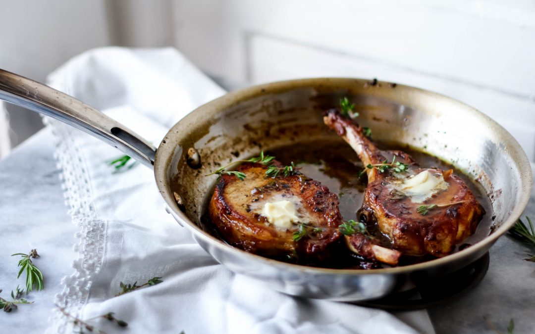 Pan Seared Butter Braised Pork Chops with Herb White Wine Reduction