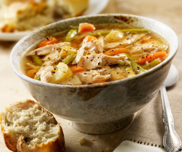 Bowl of Turkey soup with vegetables