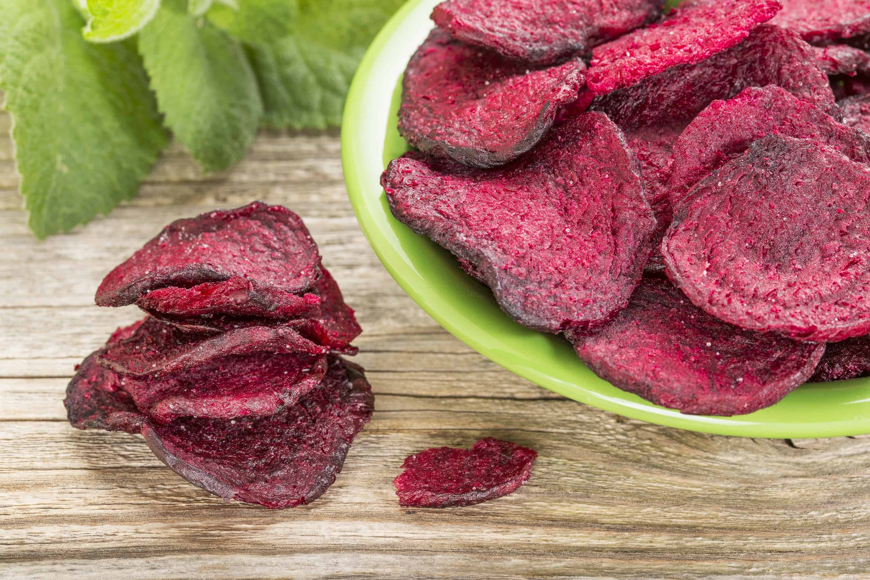 red beet chips in a green bowl - a healthy vegetable snack