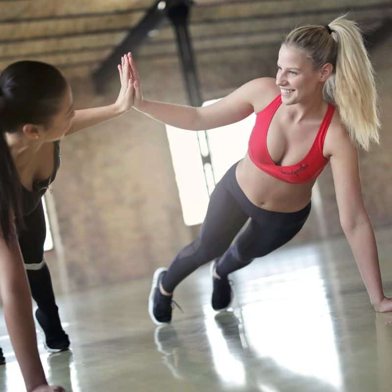 Women duo working out together like calcium & magnesium