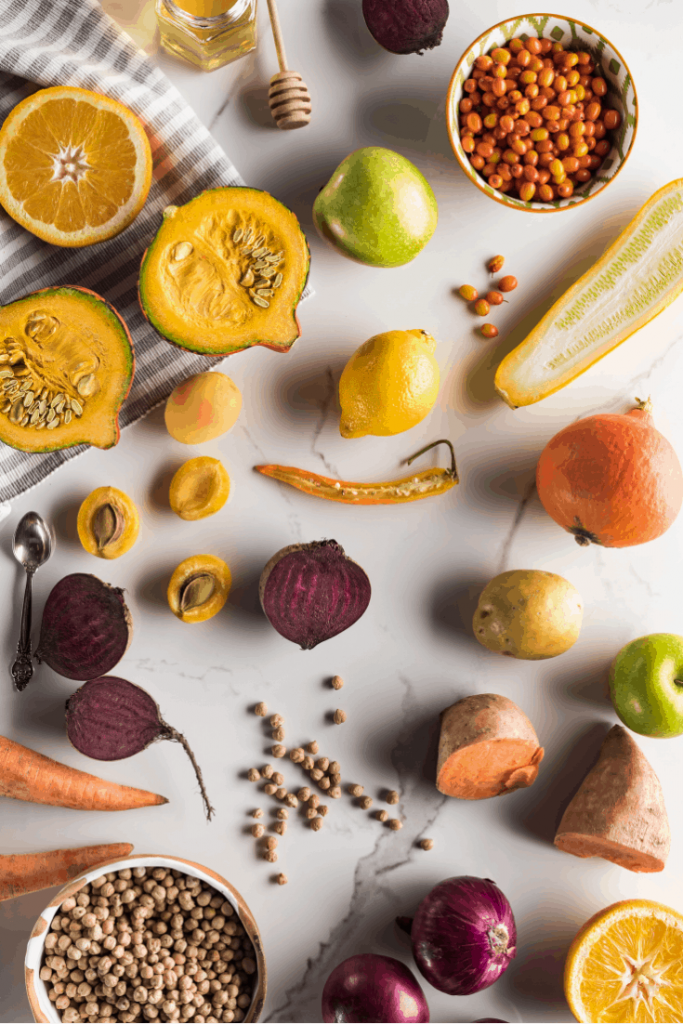 variety of fall foods on a white marble surface