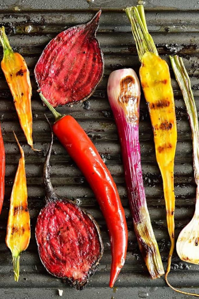 a variety of grilled veggies on a grill plate
