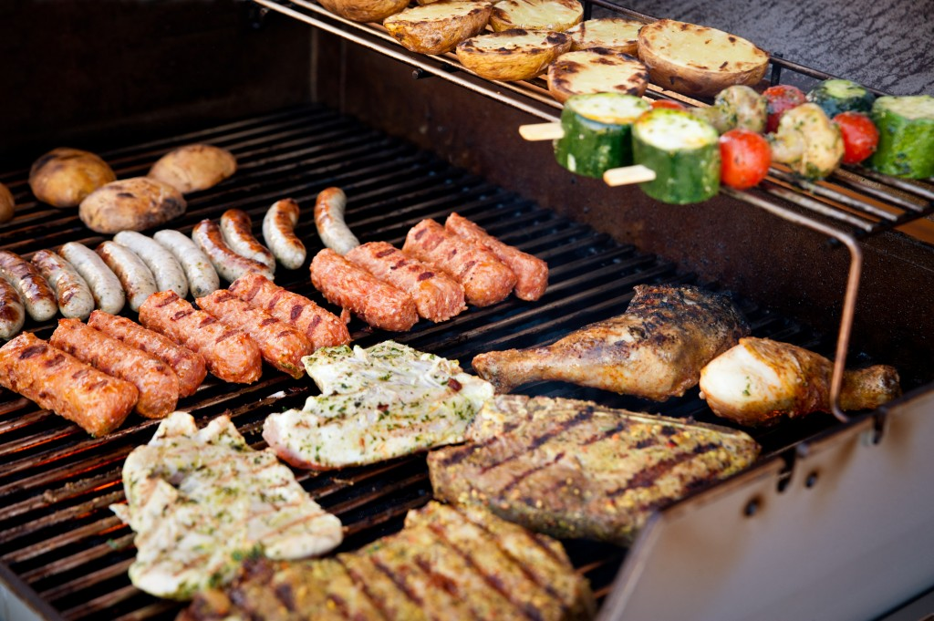 Vegetables, steak and other meat on a BBQ