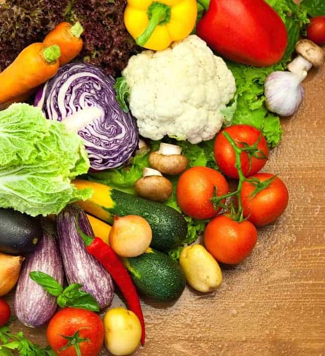 Assortment of fresh Organic Vegetables /  on the Wooden Desk / with Water Droplets