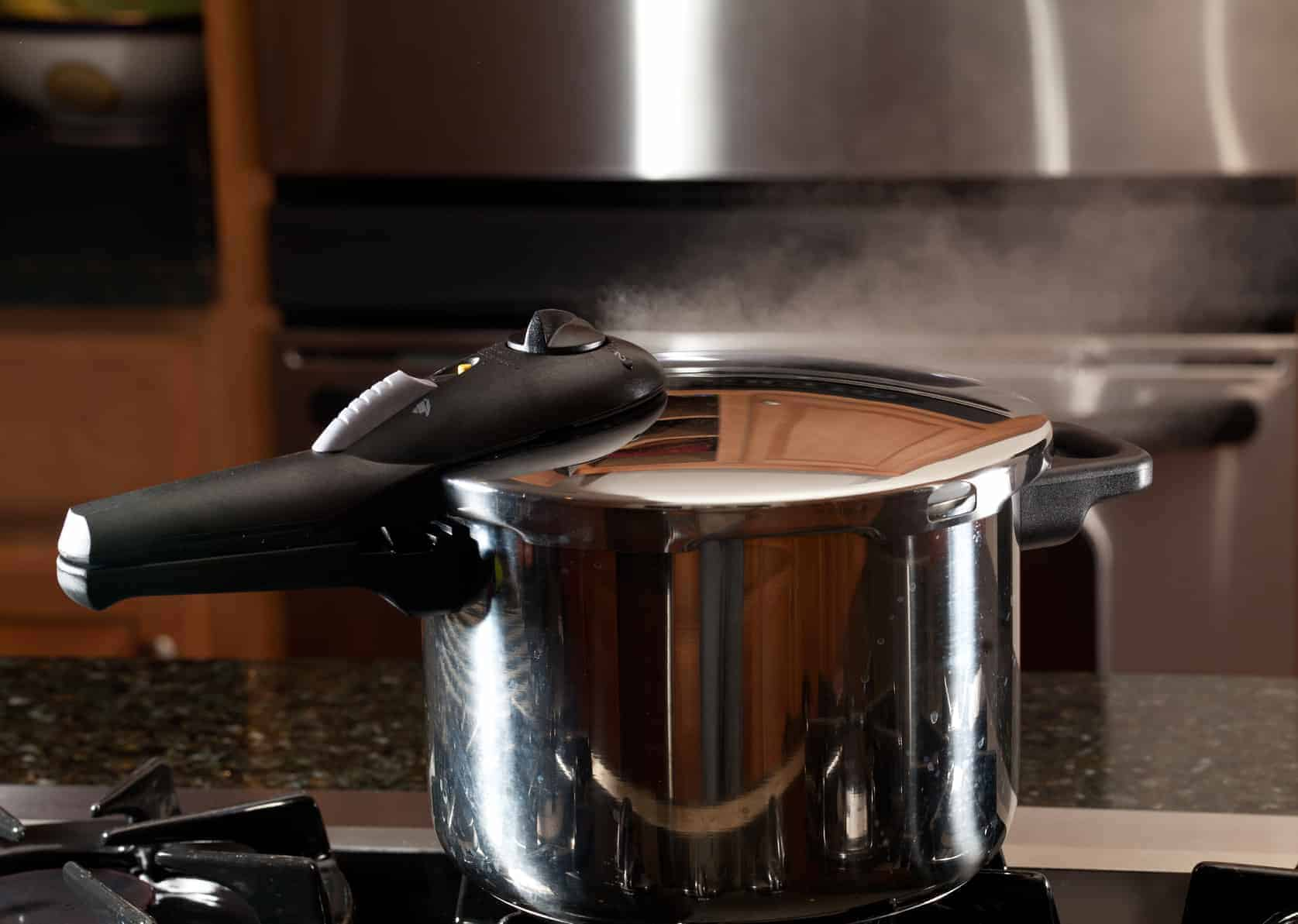 Steam escaping from new pressure cooker pot