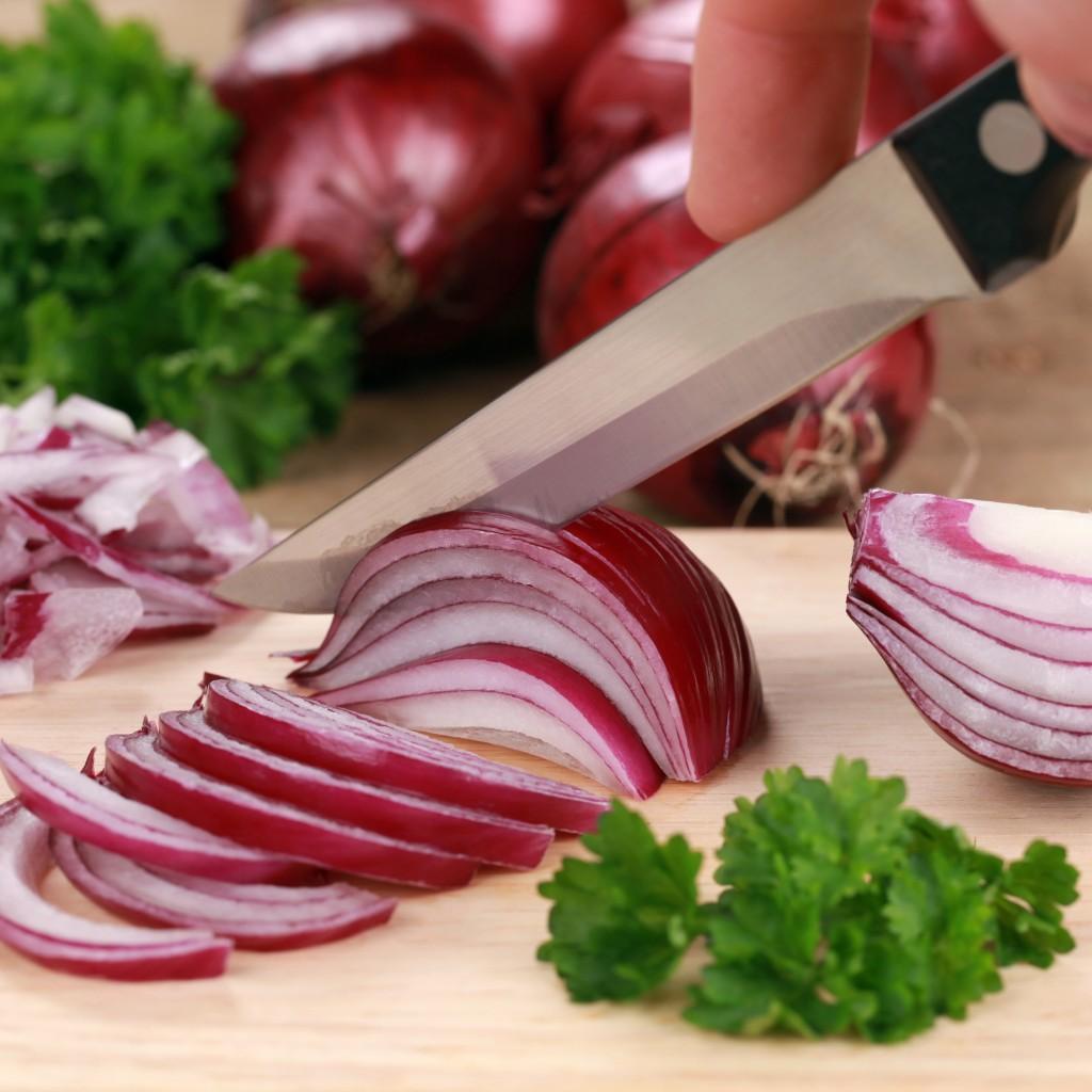 Preparing food: cutting a red onion