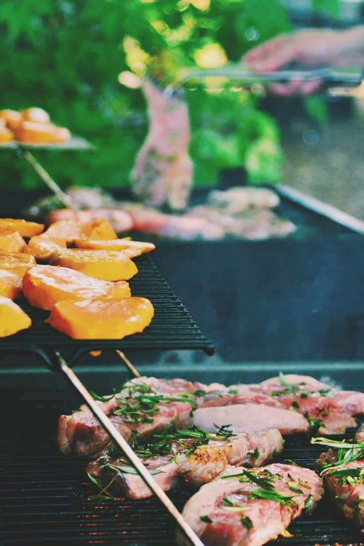A two-layer grill with steaks and vegetables