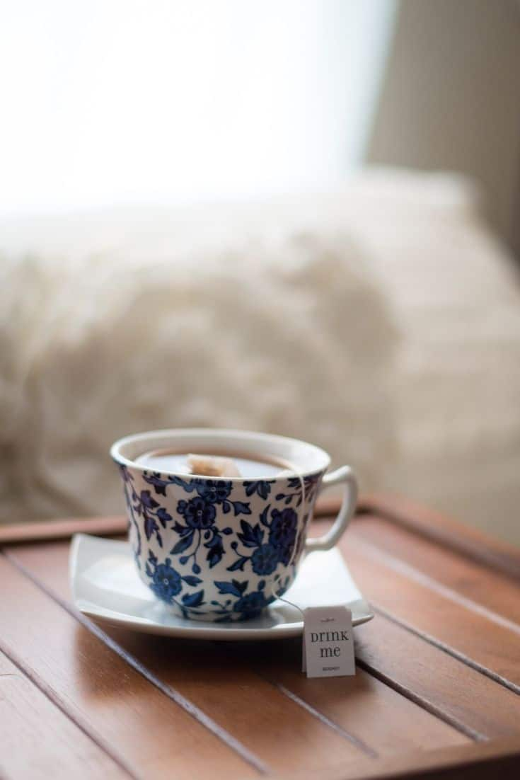 Blue flowered tea cup on a square white saucer