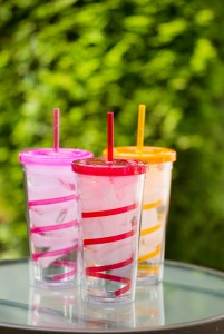 Fresh Clean Water and Ice inside of colorful cups with matching