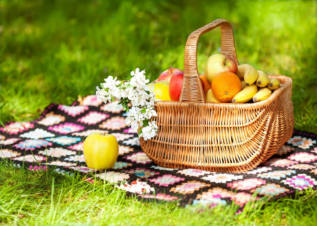 Healthy Organic fruits in the Basket. Spring. Picnic.